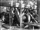 #2 Offerman well. George Crowl, driller, at brake on hoisting machinery of rig. Pierce County,...
